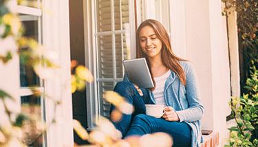 Woman_Using_Tablet_Spring_Sunshine