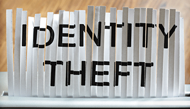 Identiy theft on paper being shredded Featured