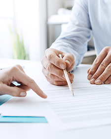 Man and woman going over a contract