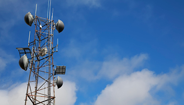 Fiber tower with blue skies Featured