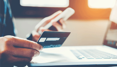 Man paying bill online Featured