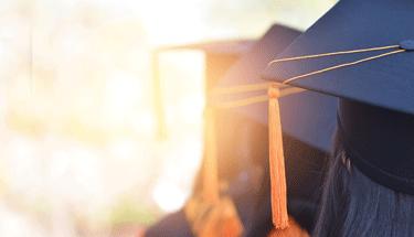 Three high school seniors graduating Featured