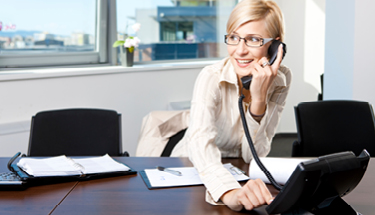 Hosted PBX phone being used by a business woman