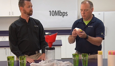 Two Arvig workers explaining speed and bandwidth