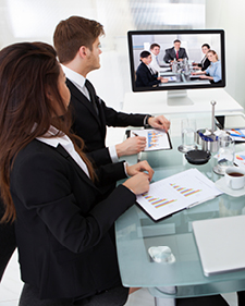 Business man and woman meeting with a team via video chat