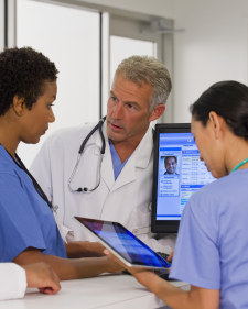 Three doctors talking about patient on tablet and desktop