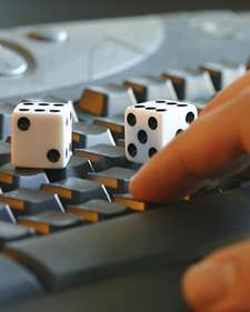 Two dice sitting on top of a keyboard that's being used